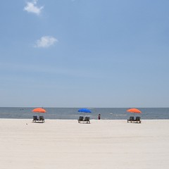 Lots of public beach chairs and umbrellas, but the flesh-eating bacteria Vibrio Vulnificus keeps a lot of people out of the water. 90% of Vibrio cases are from people eating raw Gulf oysters, the other 10% is from the bacteria entering an open wound in th