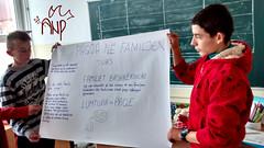 Boys Presenting Peace Paper