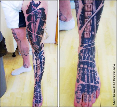 An BIOMECH arm tattoo on the whole left arm (except the part where the anbu