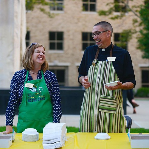 Erin Hoffman Harding, vice president for student affairs, and Fr. Pete McCormick, director of Campus Ministry, share a laugh during the student government ice cream social Thursday on North Quad.