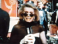 Joan Rivers on TV with me behind her