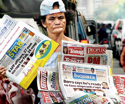 newpaper peddler philippines manila street