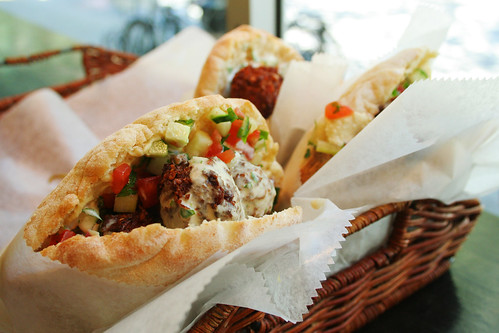 Falafel served with tahini, tomato, cucumber and pita bread.