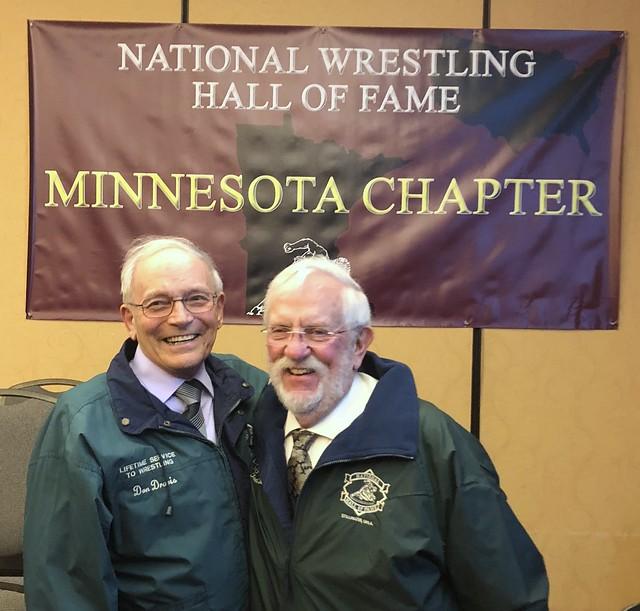 Ted Lelwica (right) presented his Green Jacket by longtime friend and Staples Coach Don Dravis.