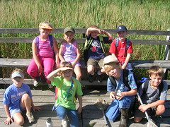 A Day Camp group rests on the boardwalk that crosses Spatterdock Pond
