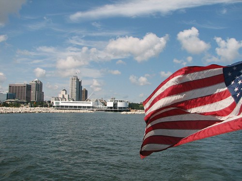 American Flag in Forground, Downtown Milwaukee and Art Museum in Background.