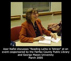 Azar Nafisi autographs her book