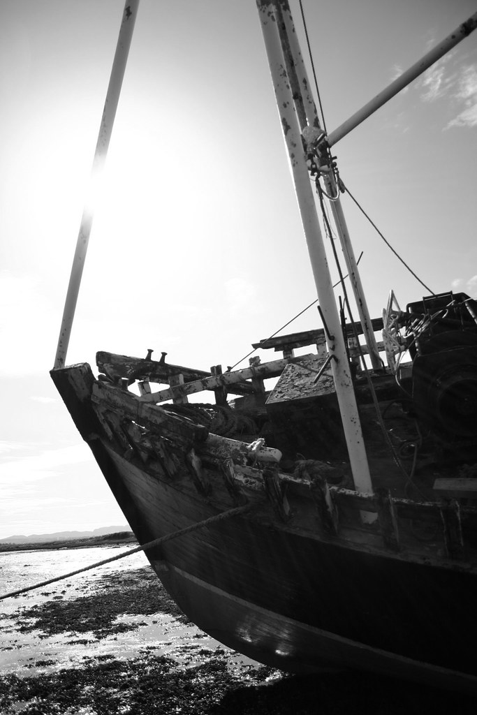 abandoned trawler black and white