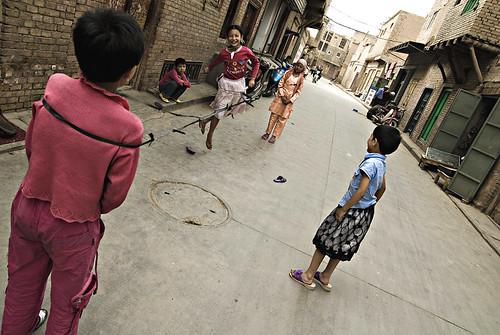 Children playing by Pawel Maciejewski