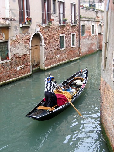 Image of a gondola in a canal in Venice.