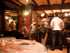 Group of people inside a pub.
