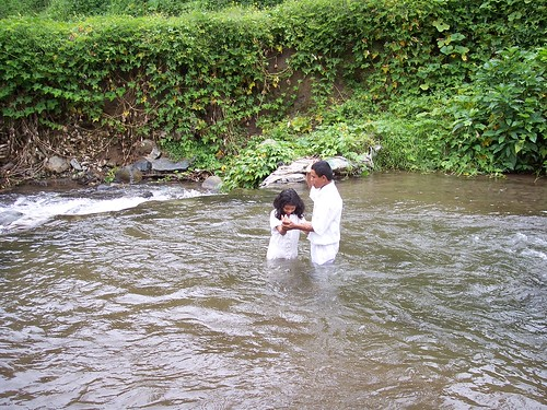 Baptism in a cold mountain stream.