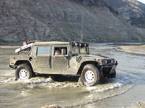 Hummer Coming out of a Lake