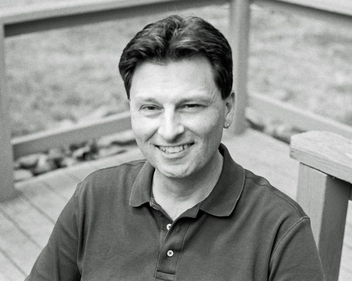A portrait of the photographer on his deck