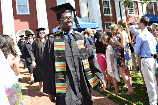 Onye Ekenta proudly walks into commencement.