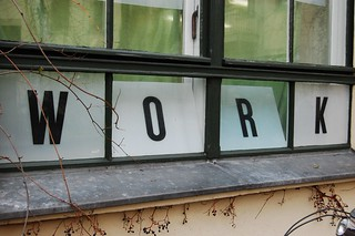 Work, spelled out on window panes