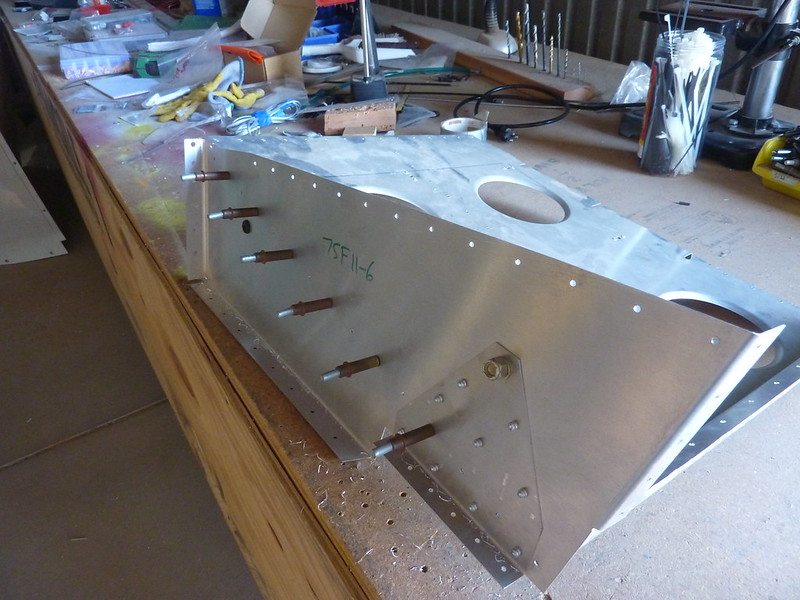 Drilling out holes in arm rest to seat base
