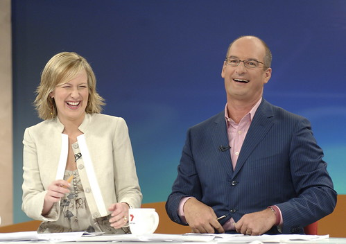 Mel & Kochie laughing on set in Melbourne