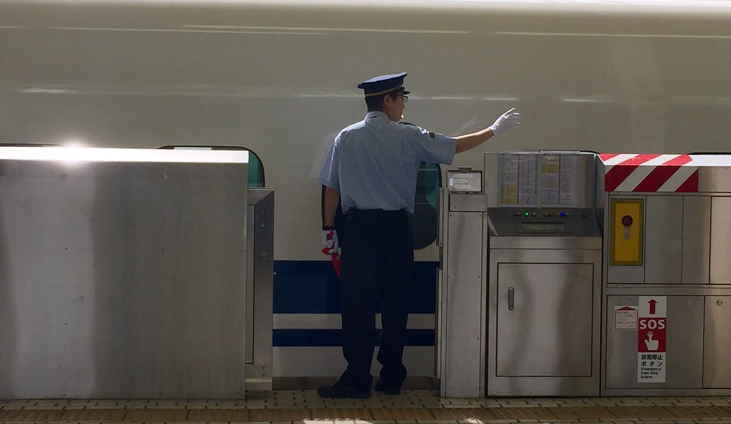 The conductor checks the boarding of people