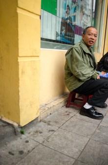 Man Siting on Street