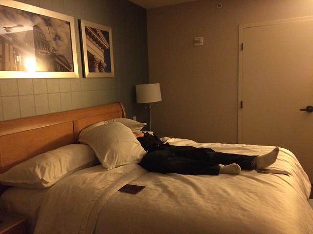 Joshua hiding under some pillows