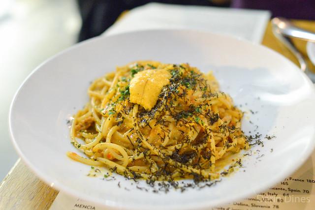 Spaghetti Rustichella. sea urchin. garlic. calabrian chilies. squid ink bottarga. breadcrumbs.