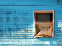 blue cliche wall with window