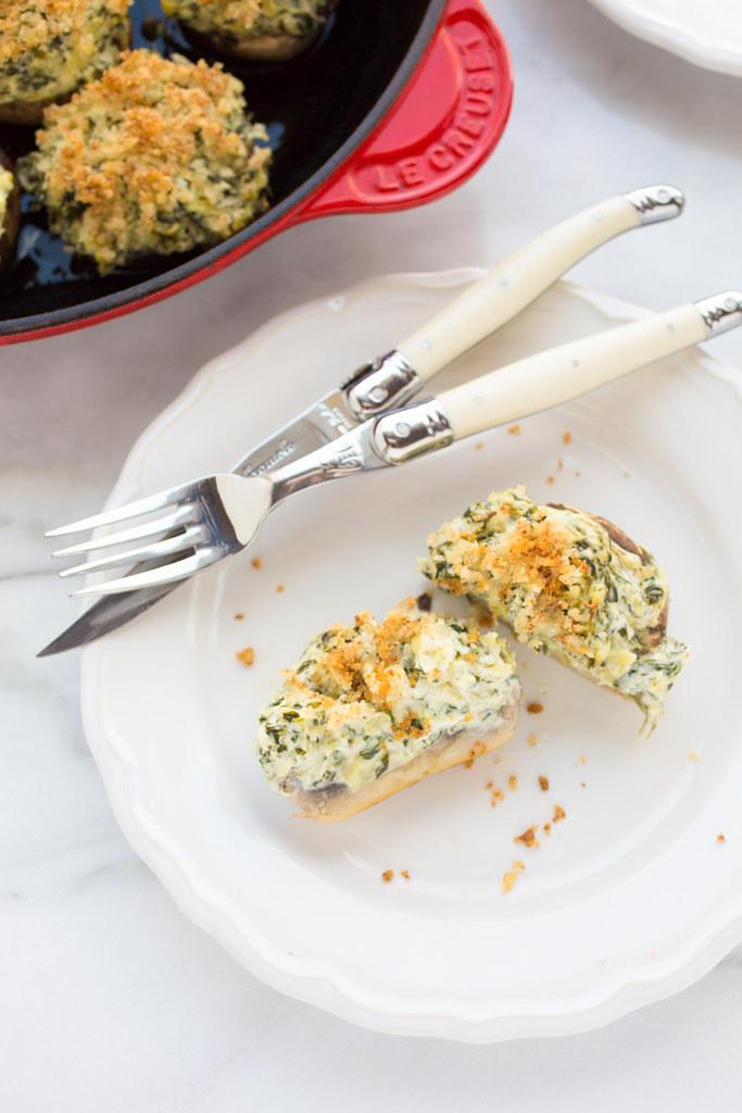 spinach and artichoke stuffed mushroom on plate