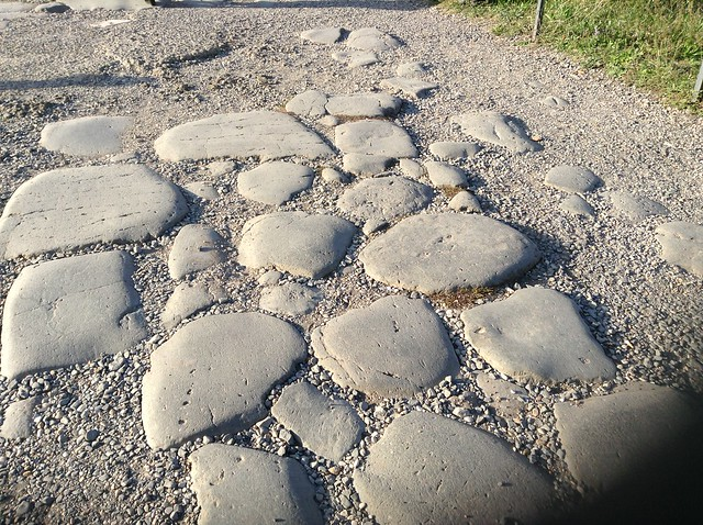 The big blocks paving ancient Roman road. If you visit the Roman forum with children, consider getting them to walk or bring a carrier