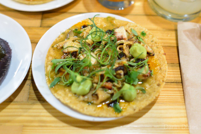 baja dried fish maw and smoked octopus tostada peanut chile de arbol salsa, lemon pickled onions, caldito jus (Plascencia)