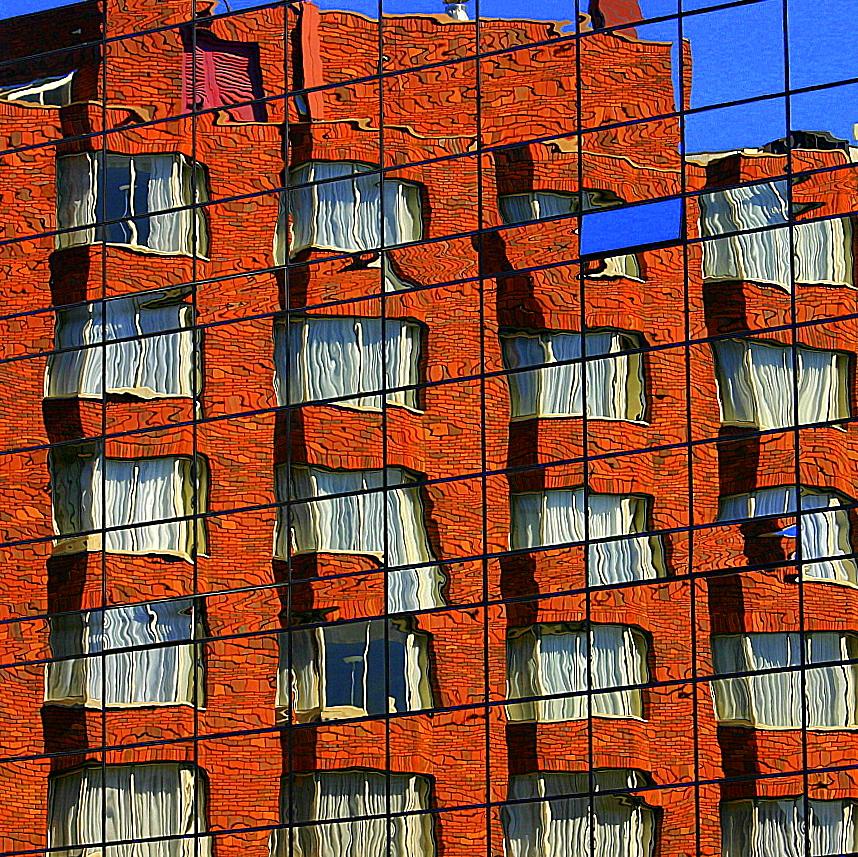 Imagen gratis de un edificio reflejado en otro