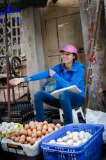 Egg Vendor with Pink Helmet