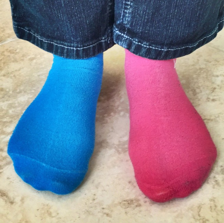 My stepdaughter's socks are channeling Flickr's logo colors