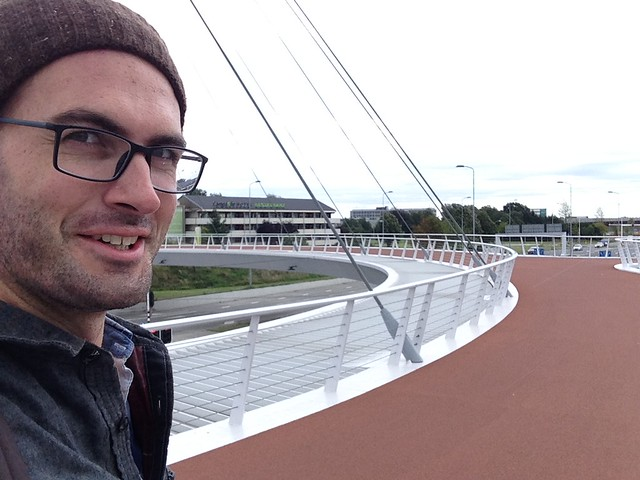 Me bicycling on the Hovenring in Eindhoven