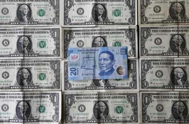 Dólar cierra en $16.90 tras anuncio de la Fed