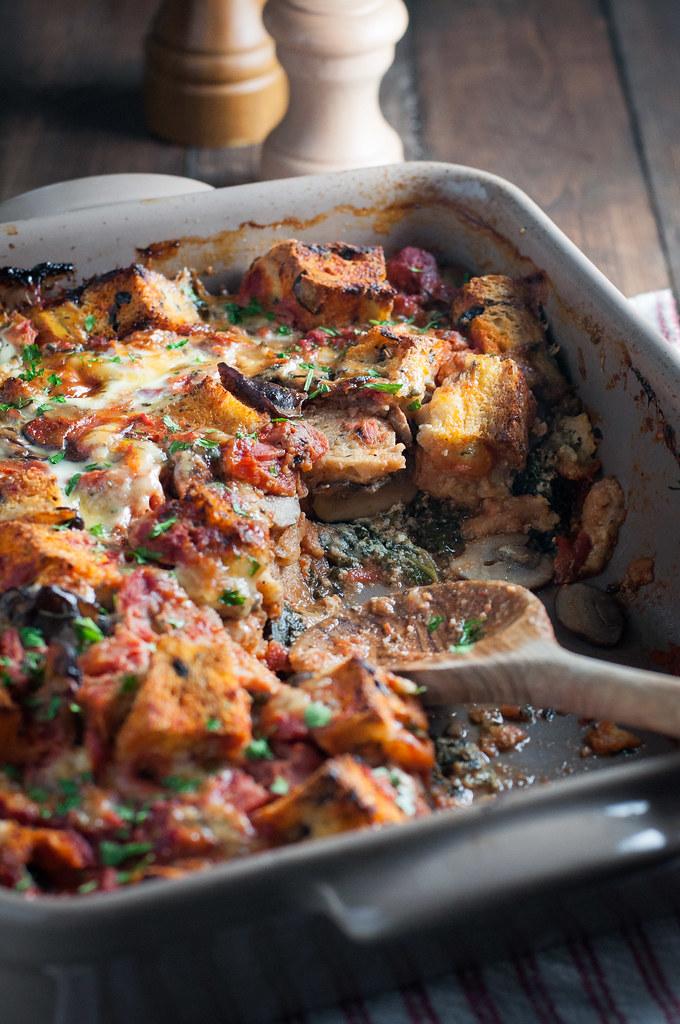 Italian overnight breakfast bake with tomatoes, greens, and mushrooms