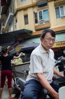 Man starting Bike at Market