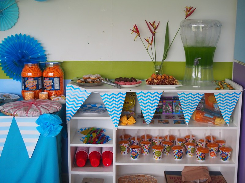 This preschool cabinet served as the dessert table, and the storage of the giveaways (the Gymboree tumblers were filled with chocolates!), grown-ups' cutlery and standby food
