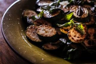 Fried zucchini with basil