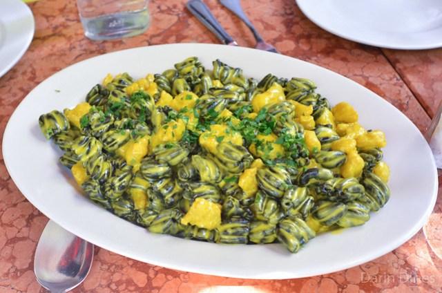 Cuffie Al Nero Di Sepia squid ink pasta with a saffron fish ragout