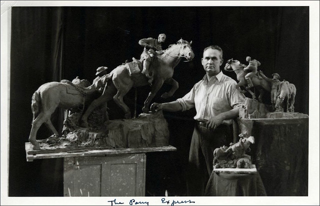 Avard Fairbanks, in his studio with preliminary models of his Pony Express sculpture, circa 1947.