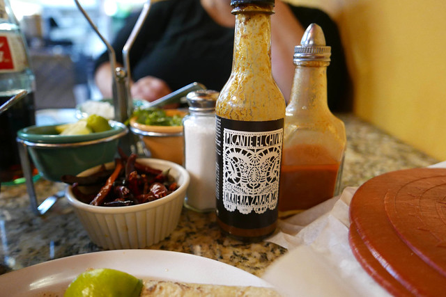 House-made sauce available for sale made with cocoa and fermented grapefruit.
