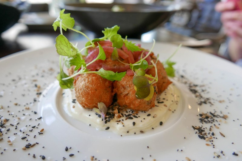 Smoked Salmon Beignets, 'everything spice', crème fraîche pickled red onion ($14)