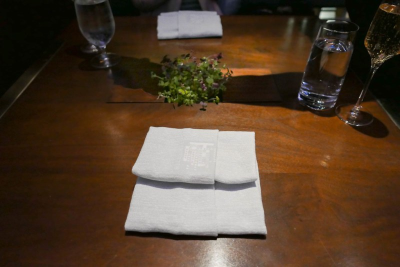 Temporis table setting with microgreens in center of custom table