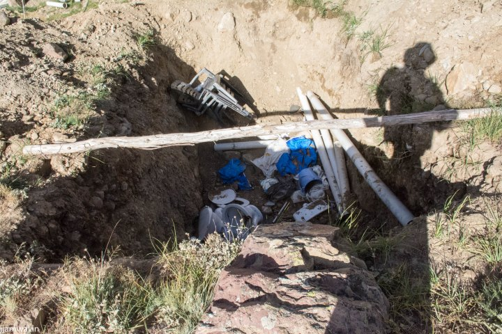 This how garbage is being disposed off. By burying in shallow pits.