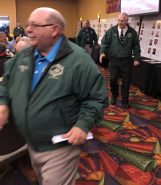 Ron Ackerman and Banquet President Scot Davis in the Green Jacket Parade of NWHOF Lifetime Service Winners.