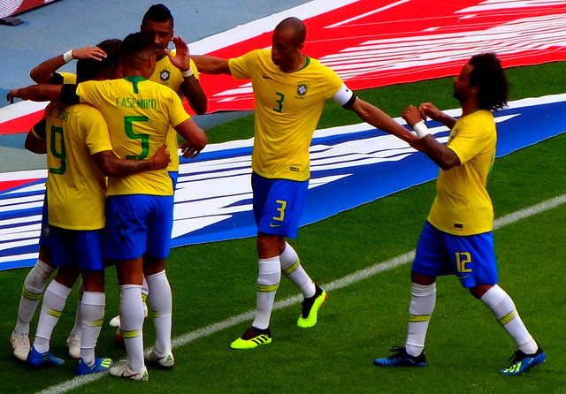 Brazil celebrate scoring against Austria