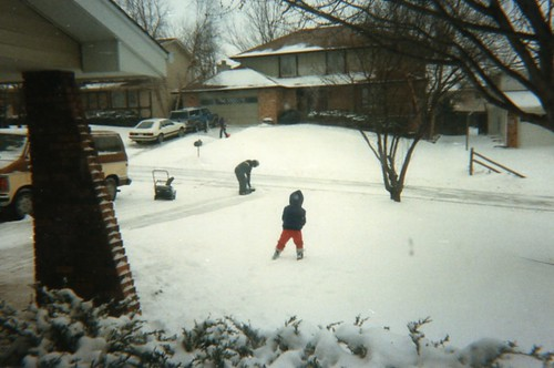 Dad snowblowing while Mark supervises