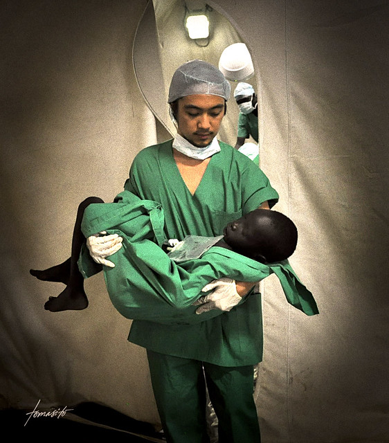 Moving African doctor saving life photography