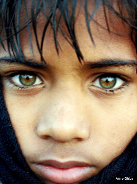 Green-eyed indian boy during Ardh Kumbh Mela |The most beautiful eyes | My National Geographic cover portrait | Somehow related to Mc Curry's Afghan Girl with beautiful eyes ?